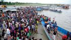 Locals and relatives gather at a beach after a ferry carrying at least 250 passengers capsized on the Padma River in Lauhajang, Bangladesh. Some 116 people are feared missing. Photograph: EPA.