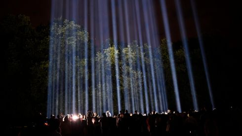 People watch an artwork entitled Spectra by Japanese visual artist Ryoji Ikeda during Lights Out, as part of commemorations to mark the 100th anniversary of the outbreak of the first World War in London. Photograph: Dylan Martinez/Reuters