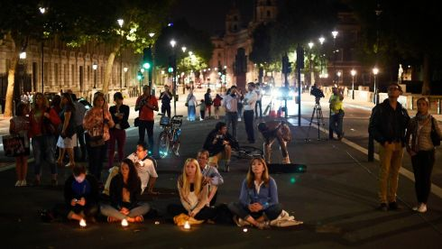 People observe a moment of silence near a war memorial in Westminster during Lights Out. Photograph: Dylan Martinez/Reuters