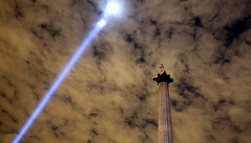 Light is beamed into the sky from Trafalgar Square to mark the centenary. Photograph: Paul Hackett/Reuters