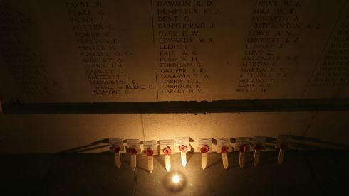 Candles illuminate the names of missing soldiers at the Menin Gate Memorial in Ypres. Photograph: Christopher Furlong/Getty Images