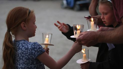 Girls at a candlelit vigil at the National Memorial Arboretum in Stafford, England. Photograph: Dan Kitwood/Getty Images