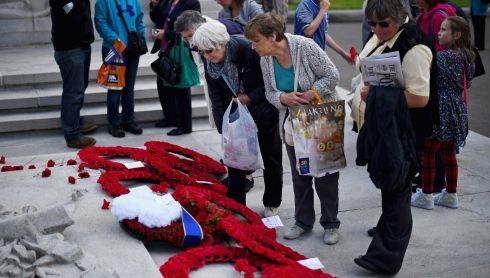 People view wreaths laid at the cenotaph in George Square, Glasgow, Scotland. Photograph: Jeff J Mitchell/Getty Images