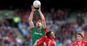 Mayo's Aidan Walsh rises to a ball during the All Ireland Senior Championship Quarter-Final, Croke Park. Photograph: ©INPHO/Donall Farmer