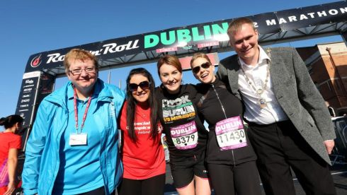 Dublin Councillor Paul Hand with competitors at the start of the race Photograph: INPHO/Donall Farmer