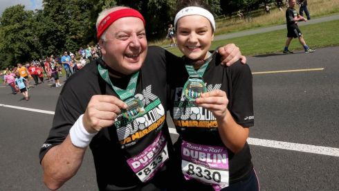 Bobby Kerr with his daughter Rebecca show their medals after the half marathon Photograph: INPHO/Donall Farmer