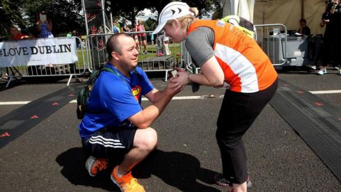 Scott Norton proposes to Deirdre Cannon from Connecticut, USA at the finish line Photograph: INPHO/James Crombie