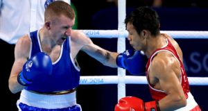 Northern Ireland's Paddy Barnes (left) on his way to gold against India's Devendro Laishram during the light flyweight bout at the Commonwealth Games in Glasgow.