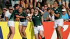 Ireland's Nora Stapleton, Ashleigh Baxter and Niamh Briggs celebrate at the final whistle in Marcoussis. Photograph: Dan Sheridan/Inpho