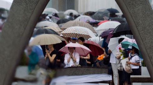 People pray for the victims of the 1945 atomic bombing in the Peace Memorial Park in Hiroshima. Photograph: Kyodo agency