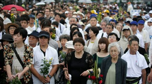 People wait their turn to offer prayers for victims of the bombing in Hiroshima. Photograph: Kimimasa Mayama/EPA