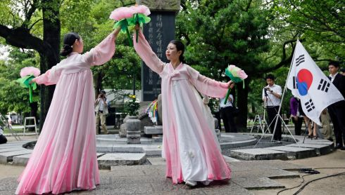South Korean residents of Japan dance in  mourning for Korean victims of the bombing. Photograph: Kimimasa Mayama/EPA