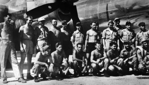 August 1945:  The ground and flight crew of the Enola Gay at Tinian in the Mariana Islands, after the atomic bombing mission on Hiroshima. Photograph: MPI/Getty Images