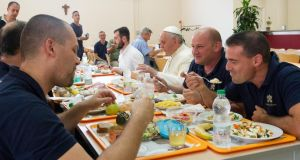 Pope Francis eating lunch   at the Vatican workers' cafeteria in July 2014. Photograph: AP Photo/L'osservatore Romano