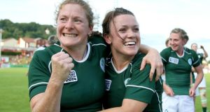 Ireland's Grace Davitt and Lynne Cantwell celebrate after their side's victory over New Zealand in the IRB Women's Rugby World Cup. Photograph: Dan Sheridan/Inpho