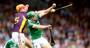 Limerick's Niall Moran beats Andrew Shore of Wexford to the ball during the sides' All-Ireland SHC quarter-final. Photograph: Inpho
