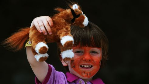 Three-year-old Evan Wade from Cashel, Co Tipperary, with his toy horse Holly at the Horse Show. Photograph: Brian Lawless/PA Wire