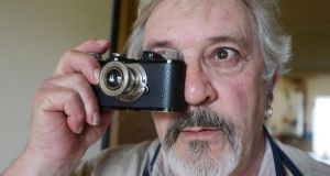 Revisiting his family's past: Andrew Kohn with his fathers Leica. Photograph: Cyril Byrne