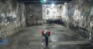Auschwitz: flowers in the gas chamber. Photograph: Andrew Kohn