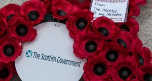 Poppie wreaths from the Scottish government at the Cenotaph in Glasgow. The war had a lasting impact on life inthe Scottish glens. Photograph: Robert Perry/EPA