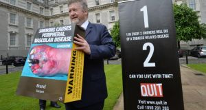 Then  minister for health James Reilly  after the cabinet's decision in June to approve the publication of the Public Health (Standardised Packaging of Tobacco) Bill 2014, which will place Ireland as the first country in the EU to legislate for plain packaging for tobacco products. Photograph: Alan Betson/The Irish Times