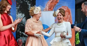 Carol Kennelly from Tralee, Co Kerry, shows her excitement on being named Best Dressed Lady at Ladies Day at the Dublin Horse Show. Photograph: Eric Luke / The Irish Times