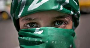 A Palestinian Hamas supporter attends a rally in Gaza City yesterday. Photograph: AP Photo/Khalil Hamra