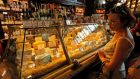 A woman looks at a variety of cheeses in a supermarket in St Petersburg. The Russian government announced a ban on food imports from the EU, US, Norway, Canada and Australia. Photograph: EPA/Anatoly Maltsev