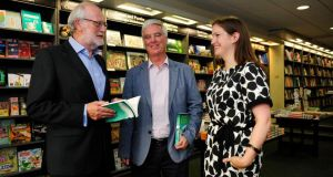 Joe Joyce (left) author of 'Echobeat', pictured at the launch of his book in Hodges Figgis, Dublin, with Stephen Collins,  Political Correspondent of The Irish Times, and Catherine Joyce. Photograph: Aidan Crawley