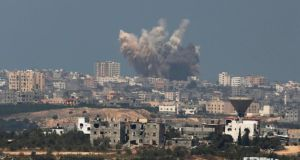 Smoke rises in the Gaza Strip after an Israeli strike today. Photograph: Amir Cohen/Reuters