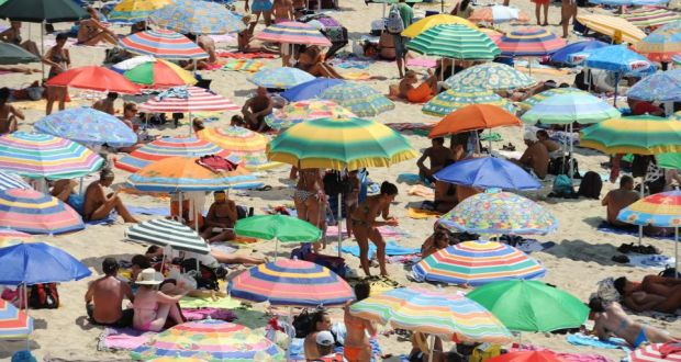 Sun Bathers On The Beach At Isola Dei Conigli In Lampedusa Italy Photograph