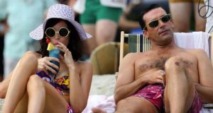 Beach chic: Jessica Paré as Megan Draper, with Jon Hamm as Don Draper, in Mad Men