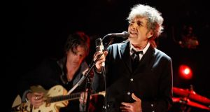 'Bob Dylan has subsequently downplayed the notion that he wrote Hard Rain's A-Gonna Fall in a hurry because he wasn't sure he'd have time to finish it. The idea that catastrophe was lurking at our elbow did, nonetheless, add a pungent flavour to cultural endeavours during the four decades that succeeded the second World War.' Photograph:  Christopher Polk/Getty Images