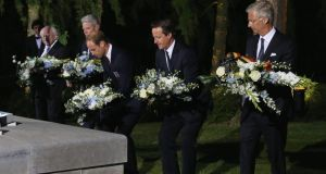 'President Higgins was escorted to the graves of a number of Irish soldiers and later laid at the obelisk a floral tribute with the Irish Tricolour entwined to commemorate all who are buried there.' Above, from left, President Higgins; the president of Germany Joachim Guack; the Duke of Cambridge; British prime minister David Cameron and King Philippe of Belgium at a ceremony at Mons, commemorating the 100th anniversary of the start of the first World War. Photograph: Gareth Fuller/PA