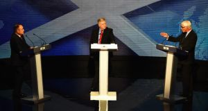 'Alistair Darling (right) unsettled his opponent, commentators seemed to agree, most effectively by repeatedly injecting doubt into the debate about Scotland's post-separation currency.' Above, with  Alex Salmond (left) First Minister of Scotland and  host Bernard Ponsonby from the Royal Conservatoire of Scotland, in the live TV debate. Photograph:  Jeff J Mitchell/Getty Images
