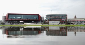 A large puddle on the outfield at Old Trafford that eventually ended play on day two of the third Test between England and India. Photograph:   Gareth Copley/Getty Images