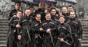 The Basiani Ensemble from Georgia singing in the rain outside Kilkenny Castle yesterday to mark the opening day of the Kilkenny Arts Festival. Photograph: Pat Moore