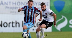 Drogheda's Gary O'Neill with Andy Boyle of Dundalk at United Park last night. Photograph: Donall Farmer/Inpho