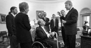 James Brady (C), along with wife Sarah and son Scott (L) meet with president Bill Clinton in the Oval Office moments before the dedication of the press office in Brady's honor in Washington in this file photo from February 11th, 2000. Photograph: Reuters
