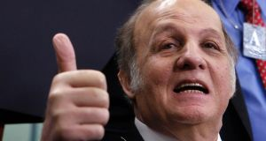 Former White House press secretary James Brady gives a thumbs-up to everyone as he visits the White House press briefing room in Washington in this  2011 file photograph.