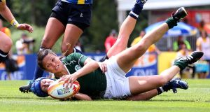 Ireland's Tania Rosser reaches for the line after a cutting through the Kazakhstan defence. Photograph: Dan Sheridan/Inpho