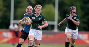 Ireland's Siobhan Fleming goes clear for her  try.  Photograph: Dan Sheridan/Inpho