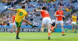 Donegal's Odhran Mac Niallais scores the opening goal of the game. Photograph: Cathal Noonan/Inpho