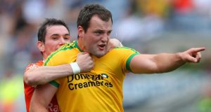 Donegal's Michael Murphy is held back by Andy Mallon early in the first half. Photograph: Cathal Noonan/Inpho