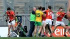 Armagh's Aaron Findon pushes over the Donegal team doctor as a scuffle breaks out in front of Hill 16.  Photograph: Donall Farmer/Inpho