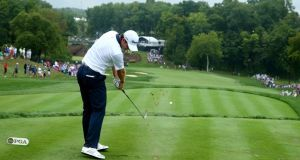 Justin Rose hits his tee shot on the 13th hole at Valhalla. Photo: Andy Lyons/Getty Images