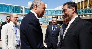 Iraq's deputy foreign minister Nizar al-Khairallah (R) welcomes French foreign affairs minister Laurent Fabius upon his arrival  in Baghdad today. Mr Fabius urged Iraq's bickering leaders  to form an inclusive government capable of countering Islamic State militants advancing through the north of the country. Photograph: Reuters