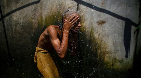 A Hindu priest takes a holy bath at Pashupatinath Temple in Kathmandu. Photograph: Navesh Chitrakar/Reuters