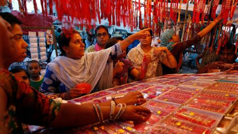 Women shop at a stall selling rakhis at a market in the western Indian city of Ahmedabad. Photograph: Amit Dave/Reuters