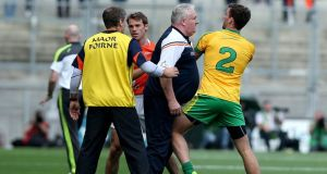 Armagh manager Paul Grimley has a word with Eamonn McGee of Donegal in the  All-Ireland football championship quarter-final at Croke Park. Photograpf: Inpho.